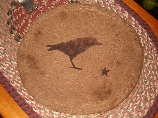 crow candle mat