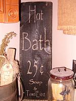 vertical hot bath sign