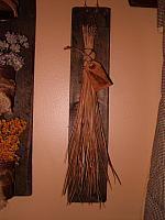 pine needle broom with wooden hanger