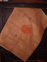 large homegrown pumpkins burlap sack