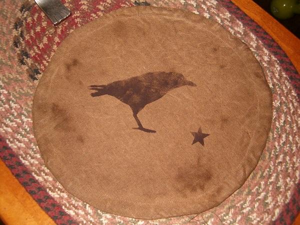 crow candle mat