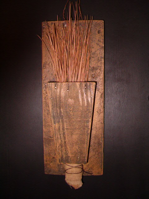 pine needle broom and holder