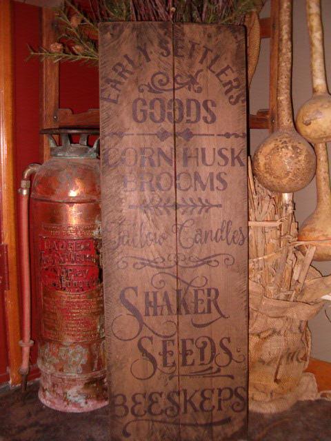 vertical Early Settler's Goods sign