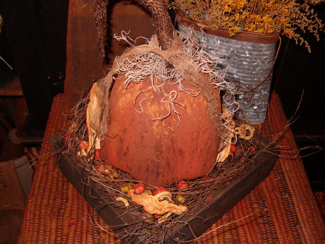 large footed pumpkin in square tray