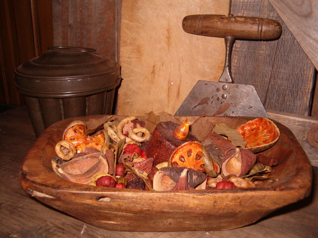 wooden bowl filled with pod mix