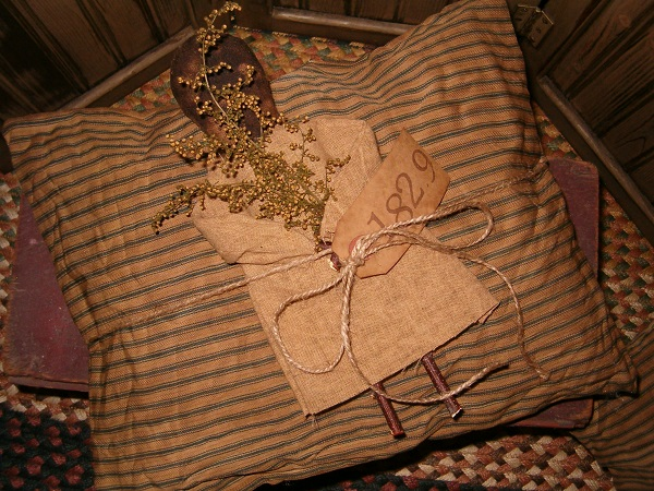 1829 blue ticking pillow with doll