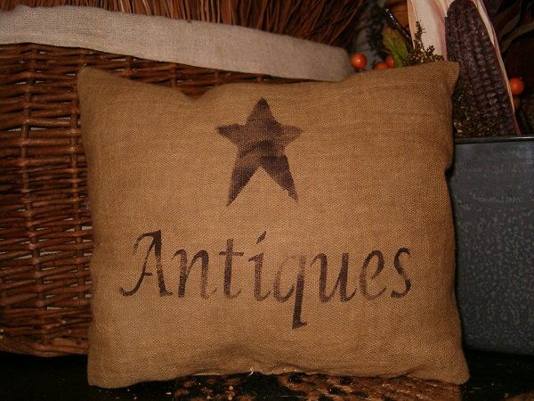 small antiques pillow with star