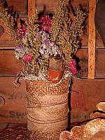 small dried floral burlap can with nubby candle