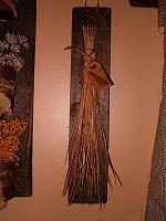 pine needle broom with wooden hanger