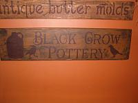black crow pottery sign