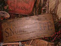 Frosty's snowflake cafe sign