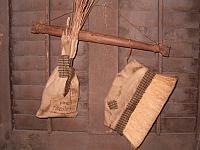 Pine needle broom hanger