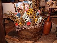 Floral stuffed burlap sack sitter