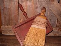 old wooden dust pan with straw whisk broom